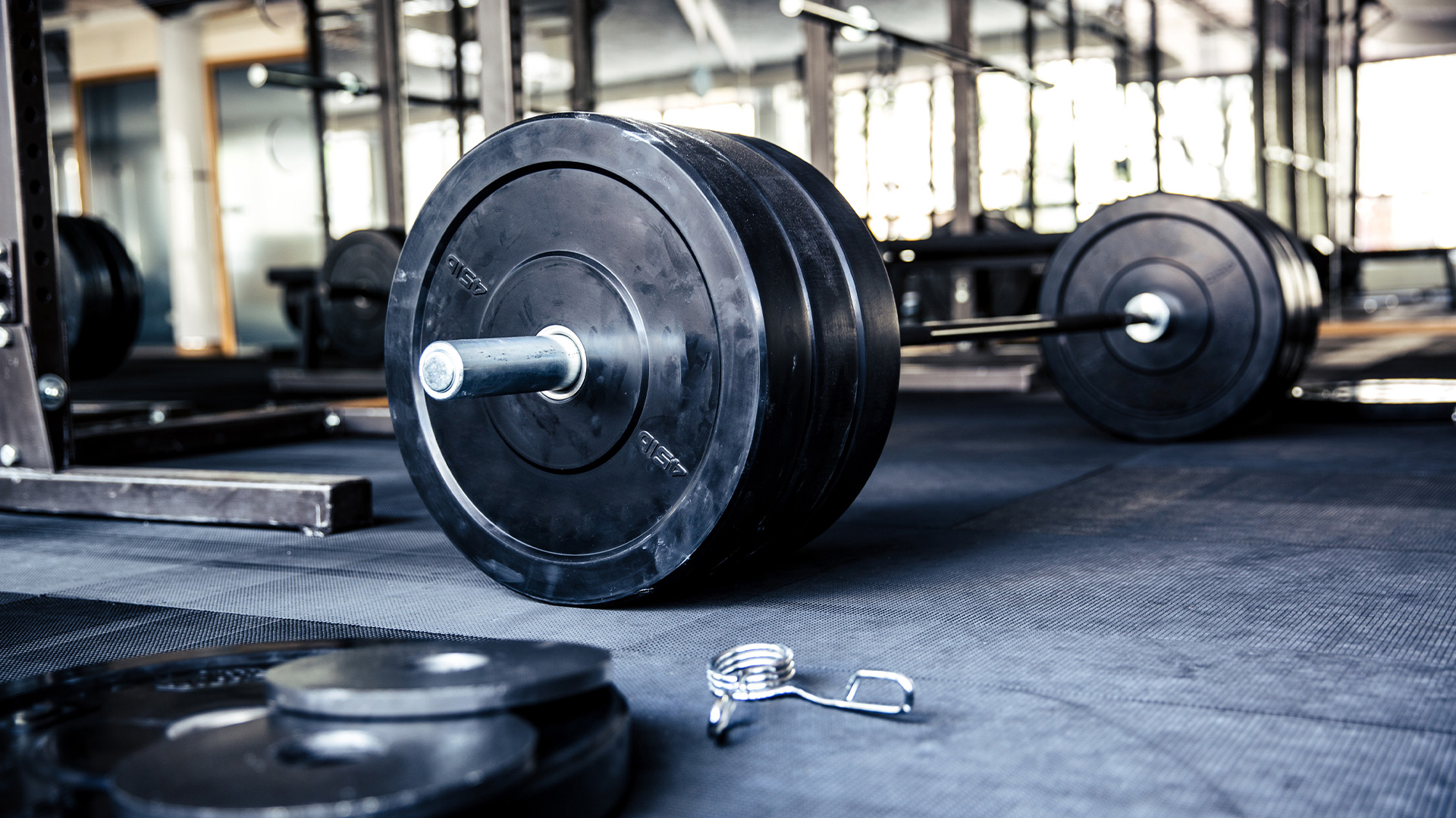 image of a barbell with weights on the floor